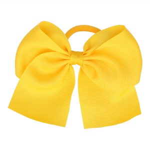 goma de pelo con lazo amarillo yela